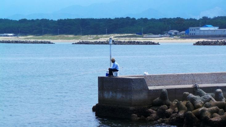 Photo des pêcheurs de l'île d'Ainoshima, Japon.